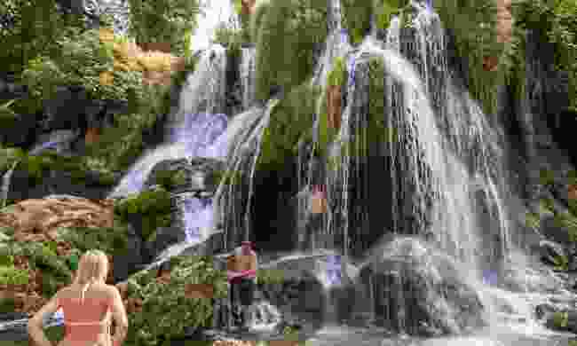 Swimmers at Kravica Waterfall  (Dreamstime)