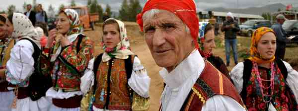 Locals wearing traditional Albanian costumes (Dreamstime)