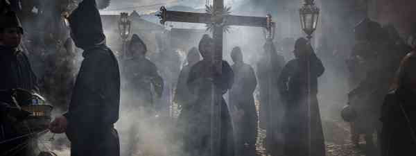 Penitents in an Easter procession during the Holy Week in Antigua, Guatemala (Dreamstime)