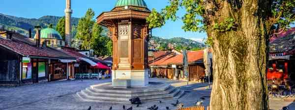 A square in Baščaršija with the Sebilj wooden fountain (Shutterstock)