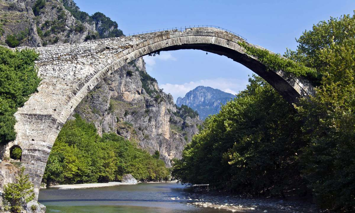 Konitsa Bridge arched over Aoos River in Epirus (Dreamstime)