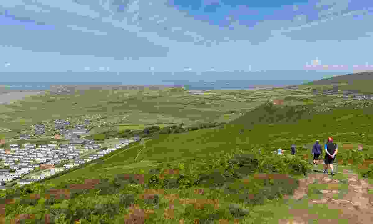Walkers on the Rhossili Down, part of the Wales Coast Path (Dreamstime)