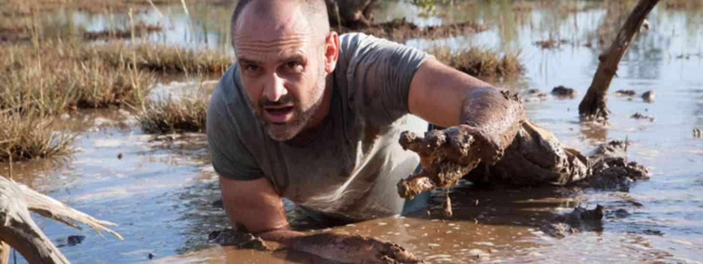 Ed Stafford crawls through mud (Discovery Channel)