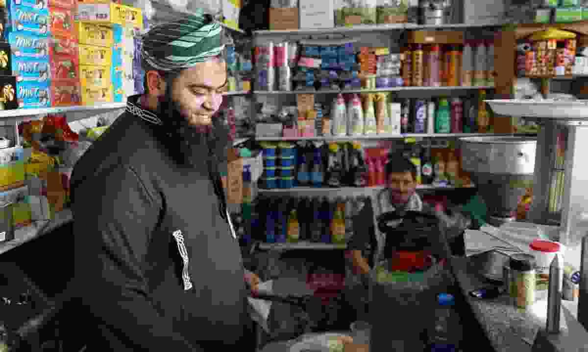 A shopkeeper in Palestine (Leon McCarron)