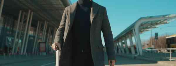 A man wearing a mask outside an airport (Shutterstock)