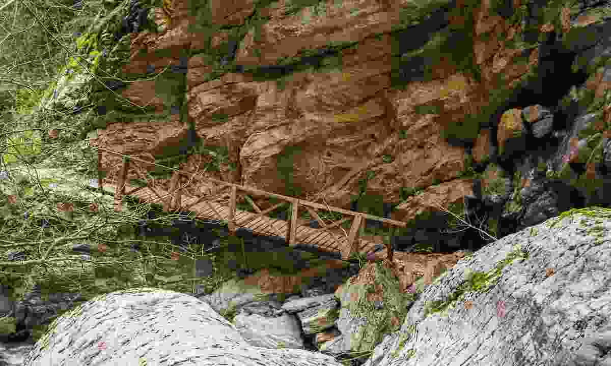 A bridge near Mavri Spilia helps people to explore the 'Black Cave'