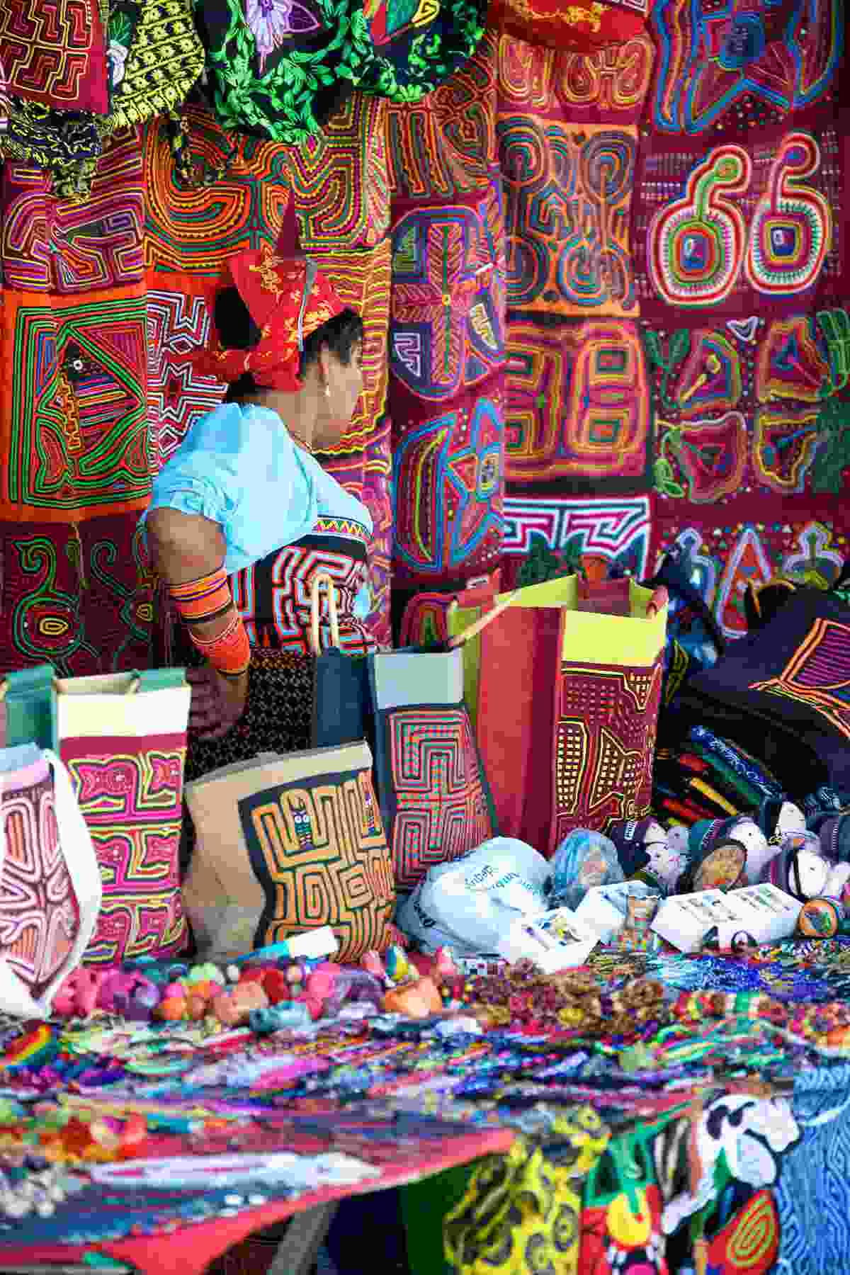 A woman behind her stall in an open air market in Panama City (Shutterstock)