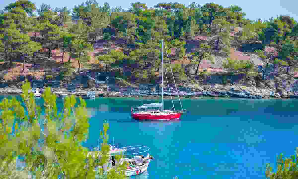 Anchored in a secluded bay near Thassos (Dreamstime)
