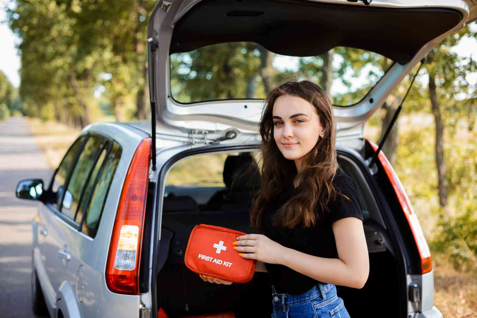 A woman with a first aid kit (Shutterstock)