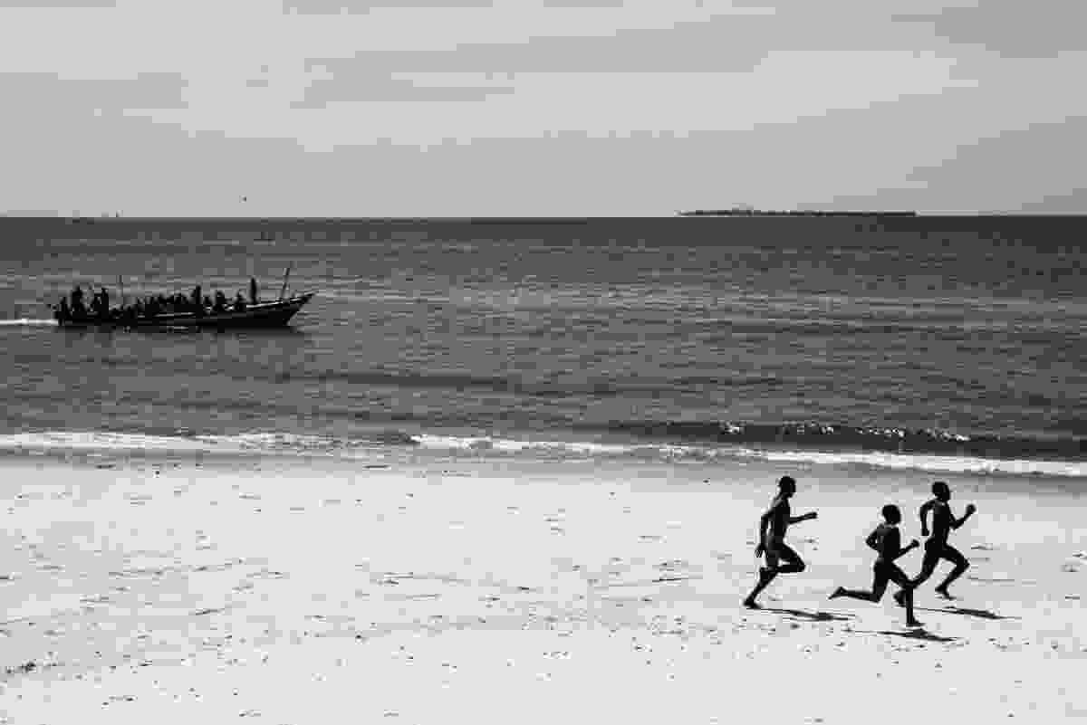 Boys running along a beach in Zanzibar (Derren Brown)