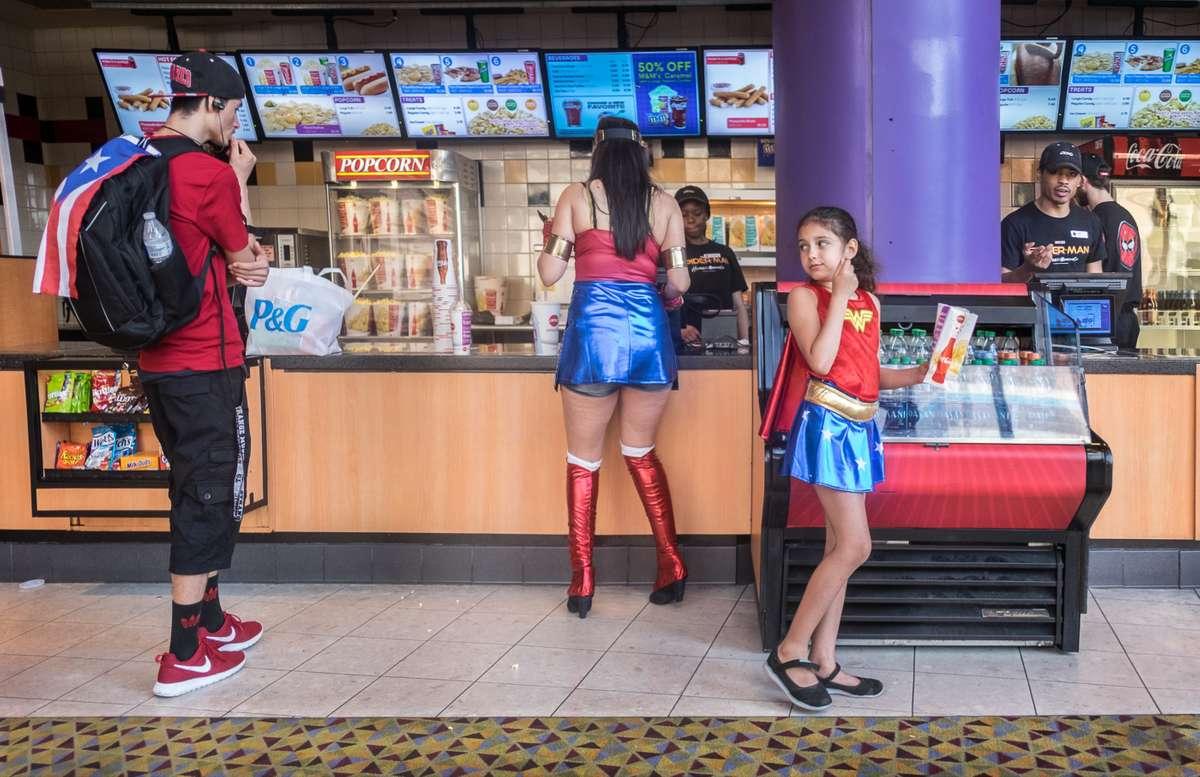 Movie goers buying popcorn, AMC Empire 25, 42nd Street, Manhattan (Richard Koek)