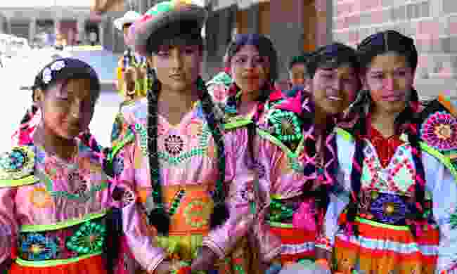 Peruvian teenagers in traditional dress (Dreamstime)