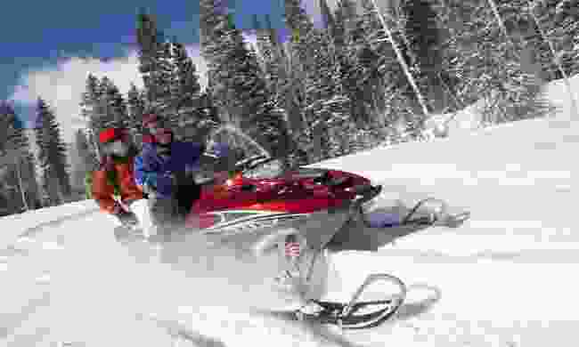 A couple on a snowmobile (Dreamstime)