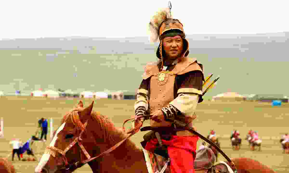 Horse archer in traditional medieval outfit (Dreamstime)