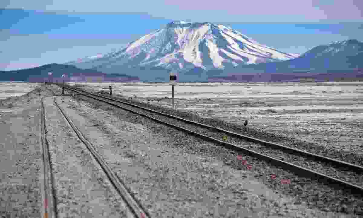 Train tracks running across the Salar de Chiguana (Shutterstock)