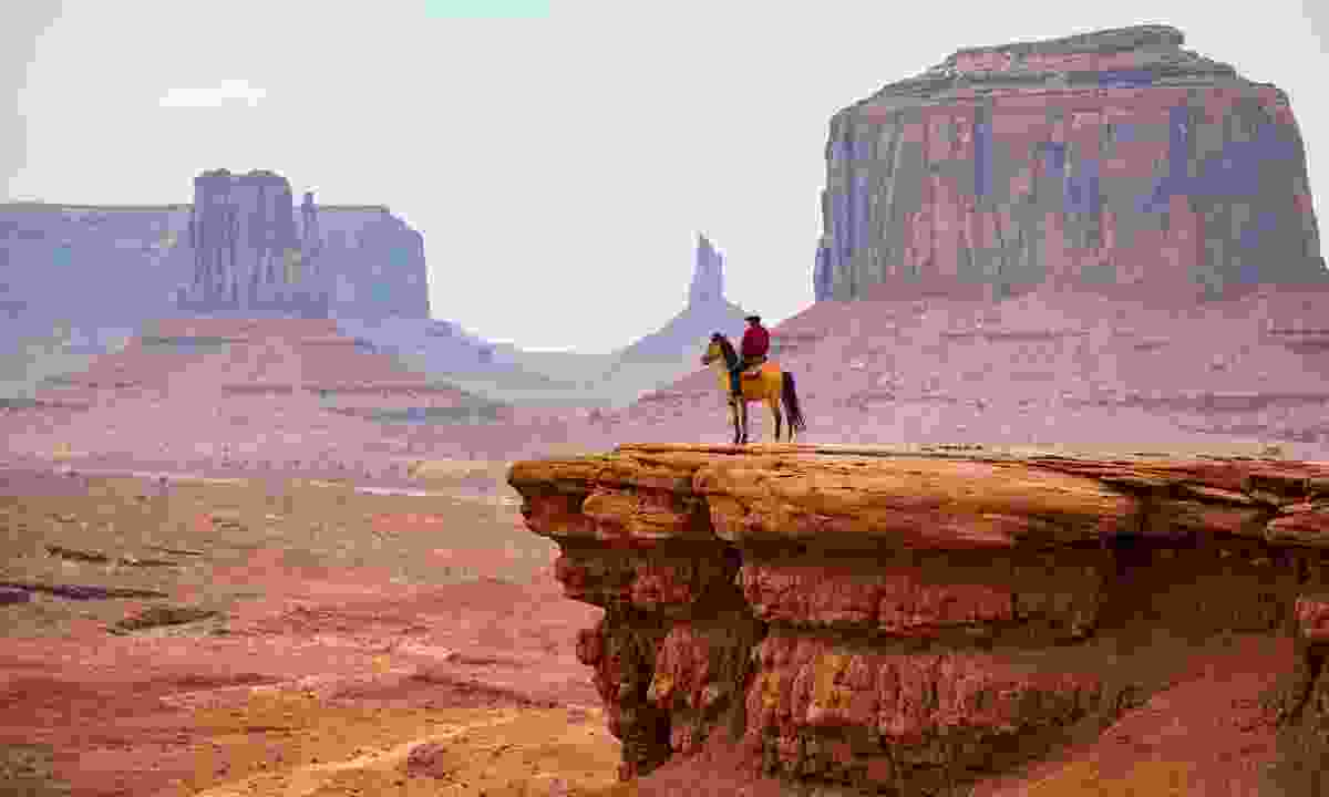 Cowboy looking at the horizon, Monument Valley Navajo Tribal Park (Shutterstock)