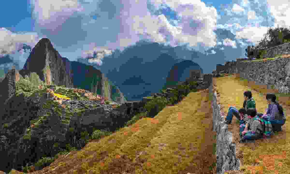 Family looking across Machu Picchu (Shutterstock)