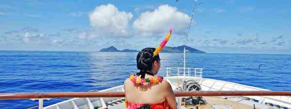 Local Tongan woman watching from boat (Shutterstock)