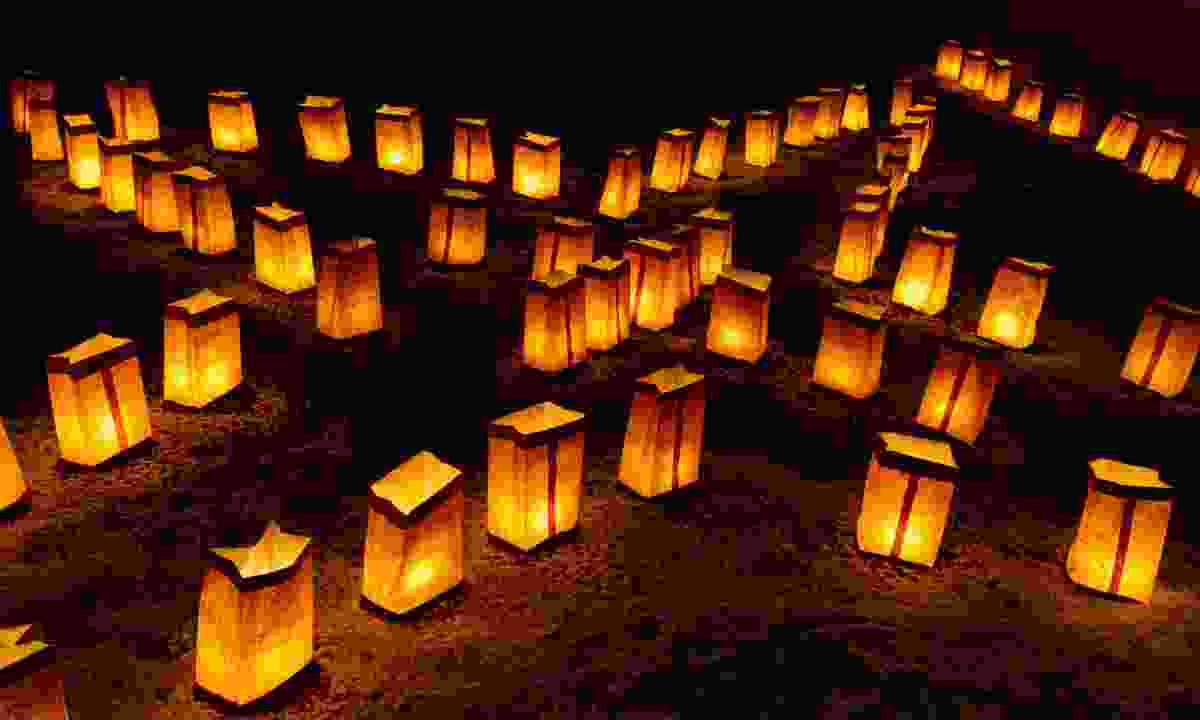 Candles illuminate paper bags at Farolito Walk (Dreamstime)