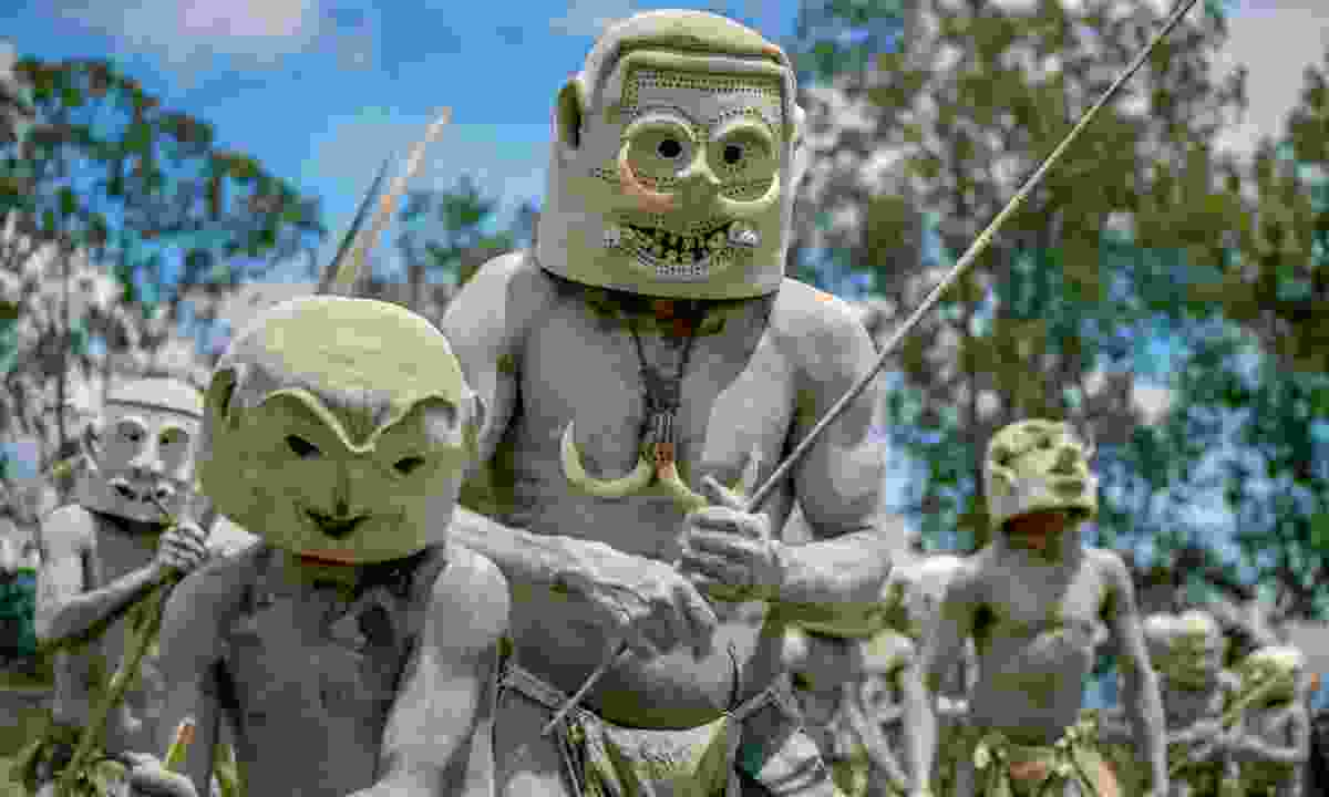 The mud-men are naked bar a loincloth and their bodies daubed in grey clay (Dreamstime)
