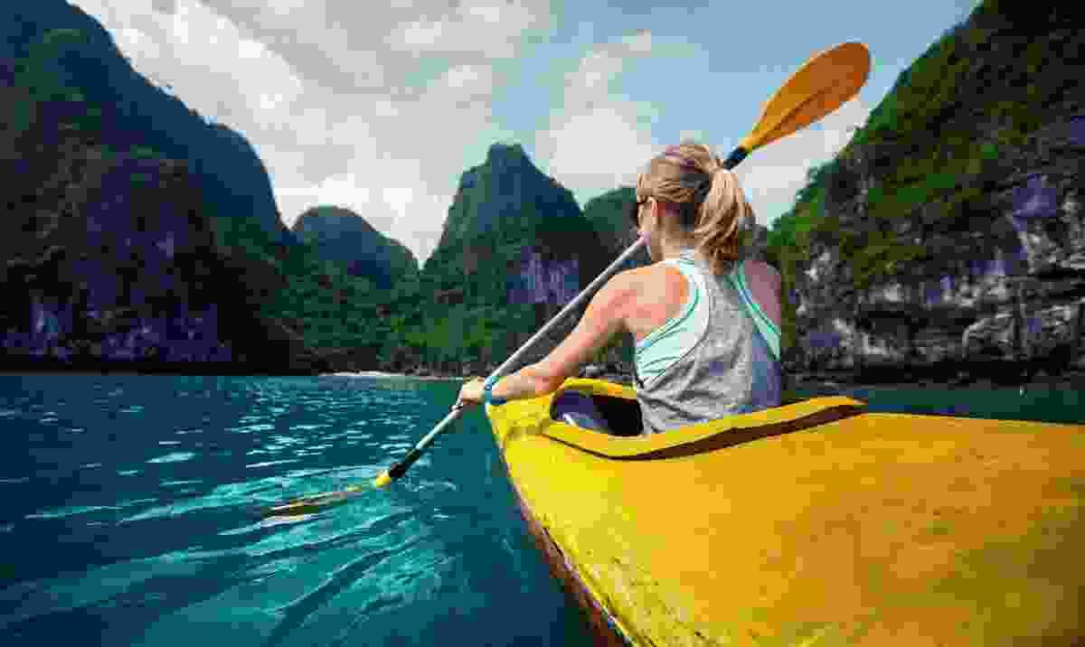Woman exploring Vietnam by kayak (Dreamstime)