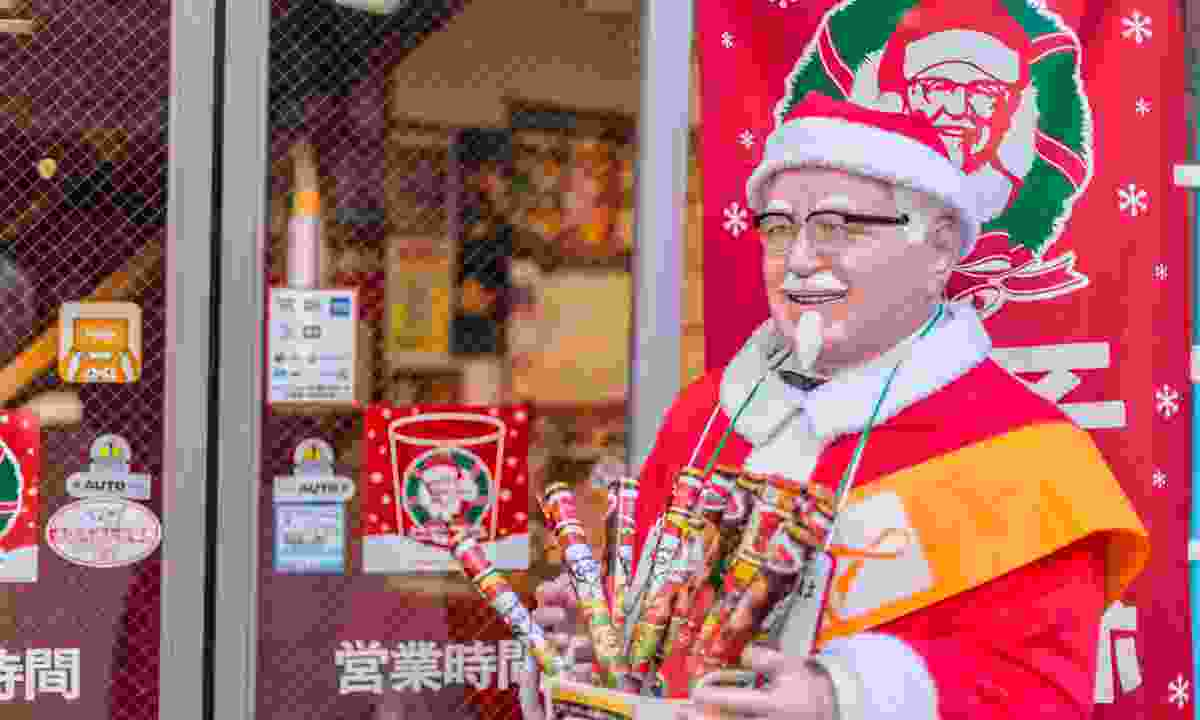 A Christmassy Colonel Sanders outside a KFC in Japan (Dreamstime)