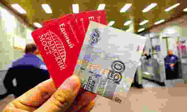 Moscow train ticket and Russian money (Dreamstime)