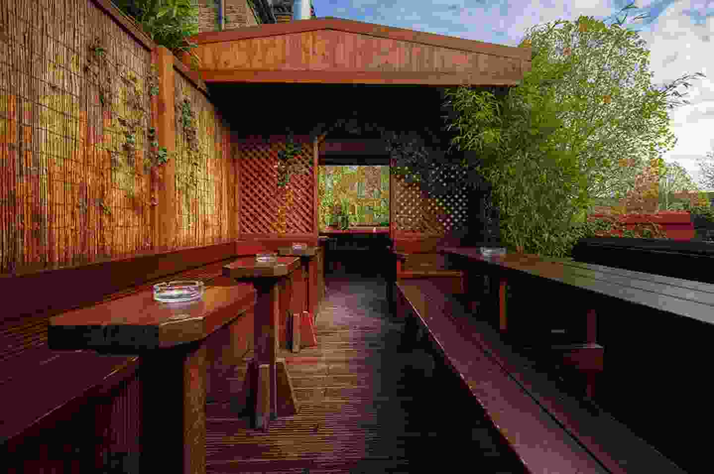A covered terrace at the top of the garden (Faltering Fullback)