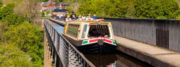 High waters: Narrowboat passengers take in the views as the Llangollen Canal crosses the Pontcysyllte Aqueduct (Shutterstock)