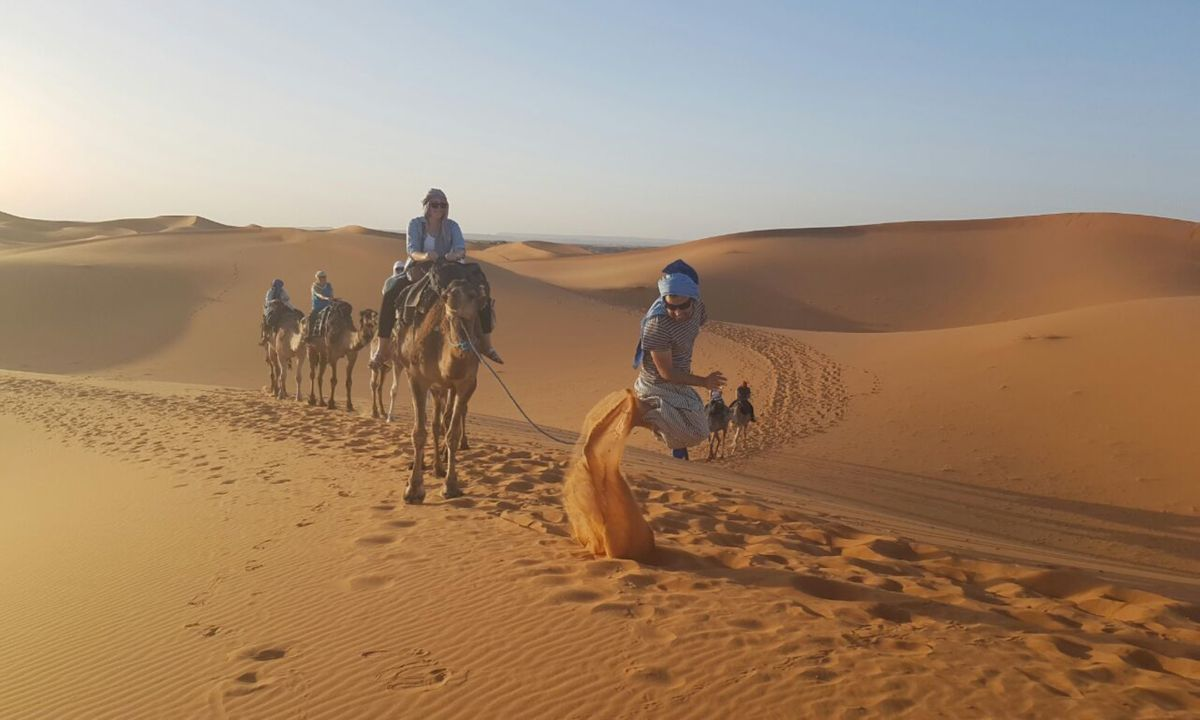 Khalid Lamlih leading a tour group in Morocco (Intrepid Travel)