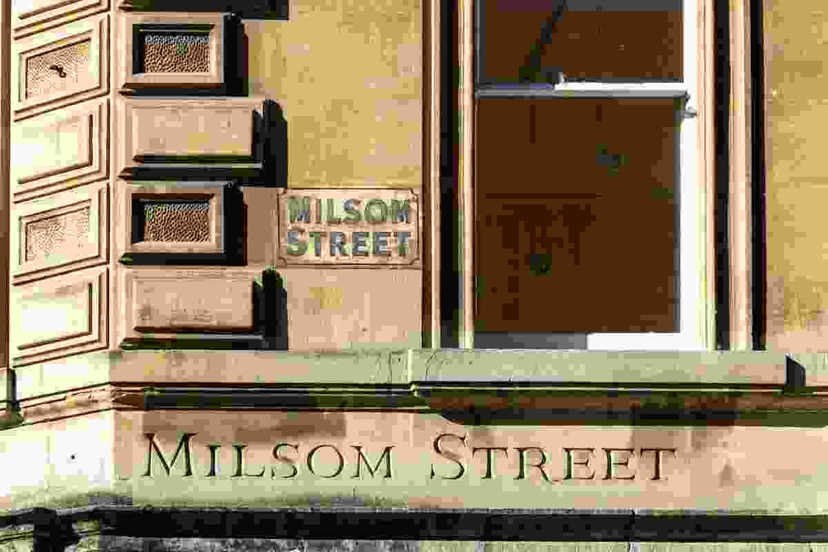 Milsom Street's two street signs, in Bath. The street was featured heavily in Jane's books (Shutterstock)