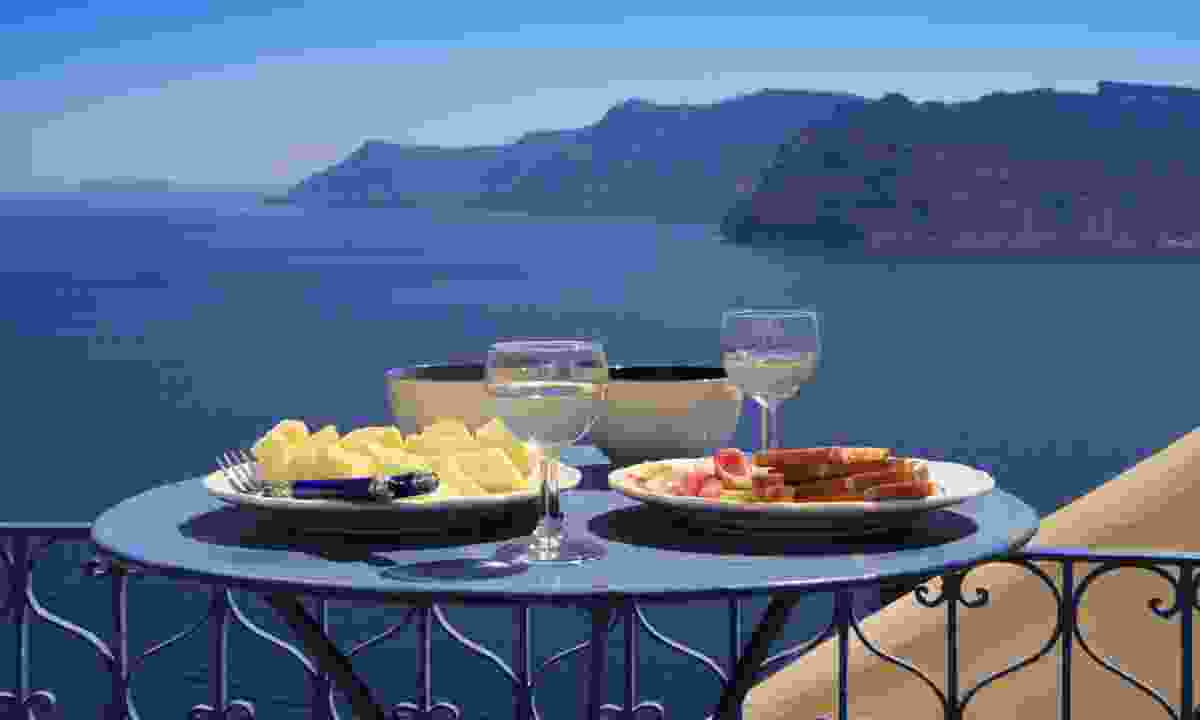 Food with a view on Santorini (Dreamstime)