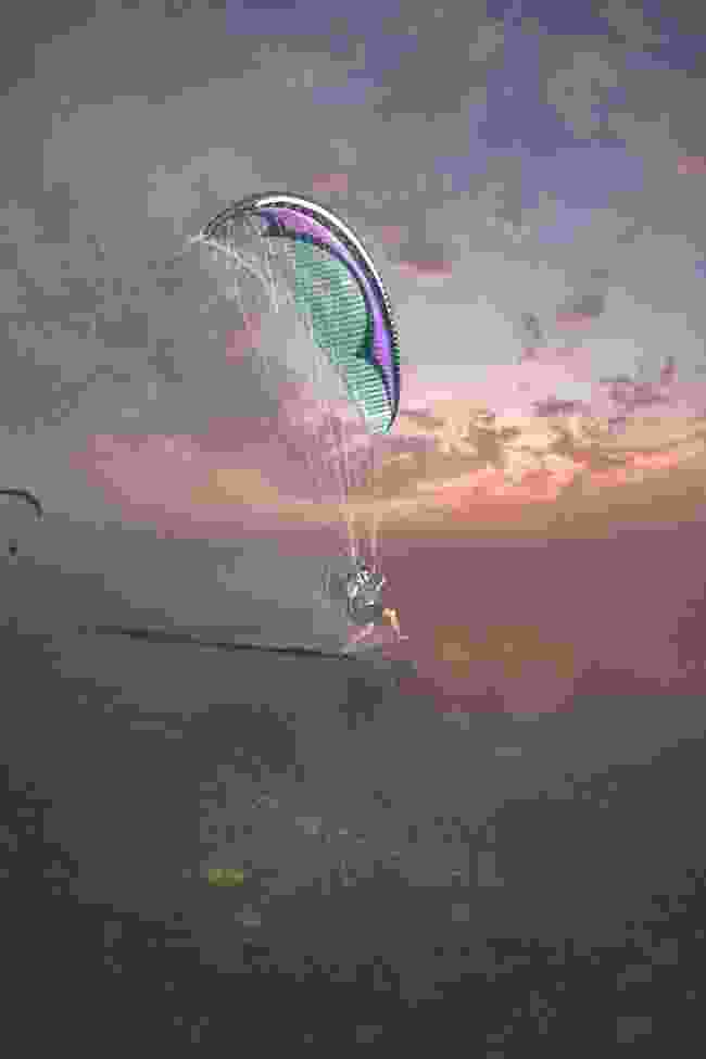Paramotor pilot Bob Frankham skims over the Dead Sea at Sunset (Fergus Kennedy)