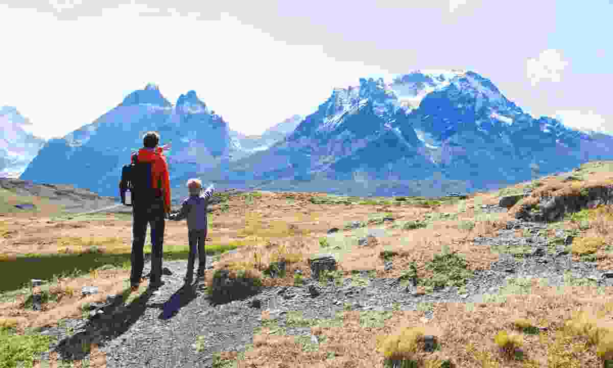Father and son hiking in Torres del Paine, Patagonia (Dreamstime)