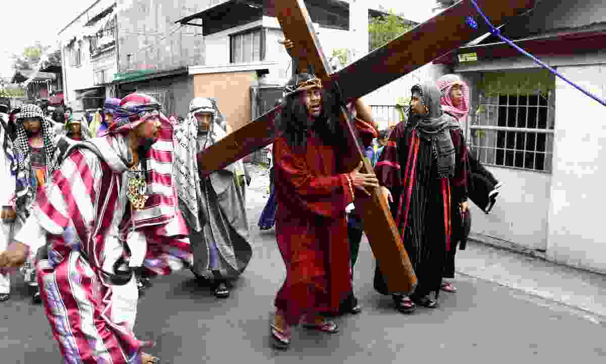 Locals take part in the reenactment of the Passion of Christ, held on Good Friday as part of celebration of the Holy Week in the Philippines. (Dreamstime)