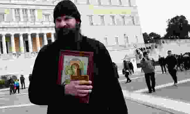 A priest with his icon (Shutterstock)