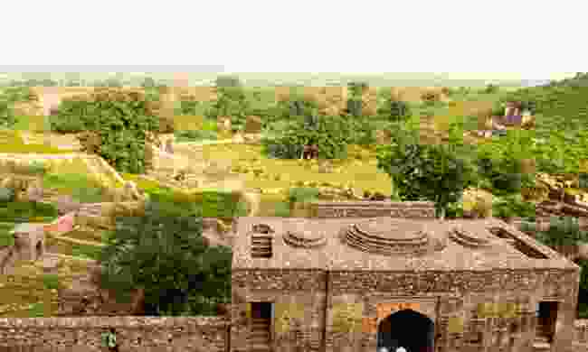Tourists visiting the ruined fortress in the ancient city of Bhangarh. This palace is said to be cursed and entry during night is prohibited (Dreamstime)