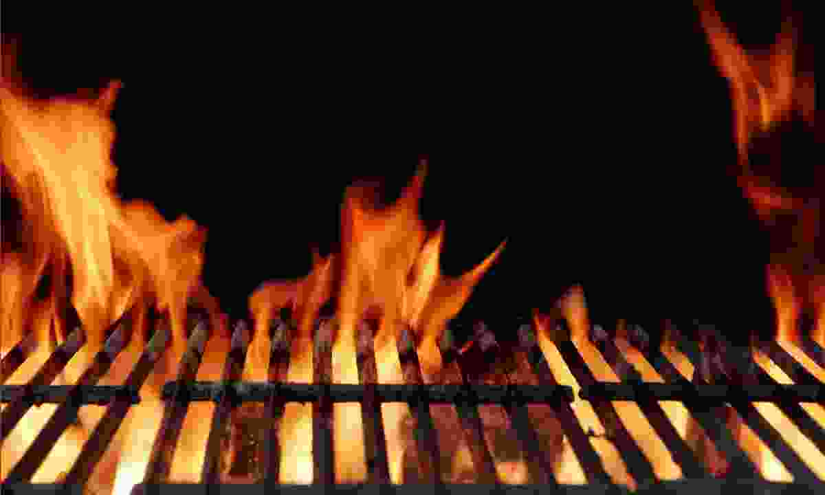 Flames on a barbecue (Shutterstock)