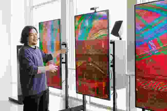 HIGA Satoru with his artwork on display at Naha Airport as part of CULTURE GATE to JAPAN