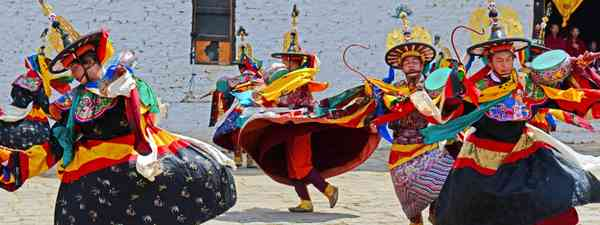 Masked dancers in Bhutan (Dreamstime)