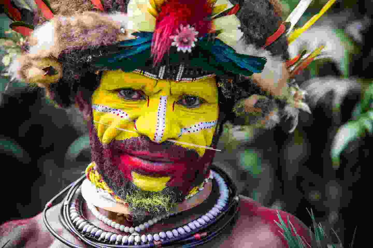 The men of the Huli tribe in Tari area of Papua New Guinea in traditional clothes and face paint (Shutterstock)