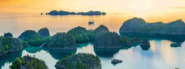 Schooner or later: The Katharina moored next to wild islets in Raja Ampat (Alex Robinson)