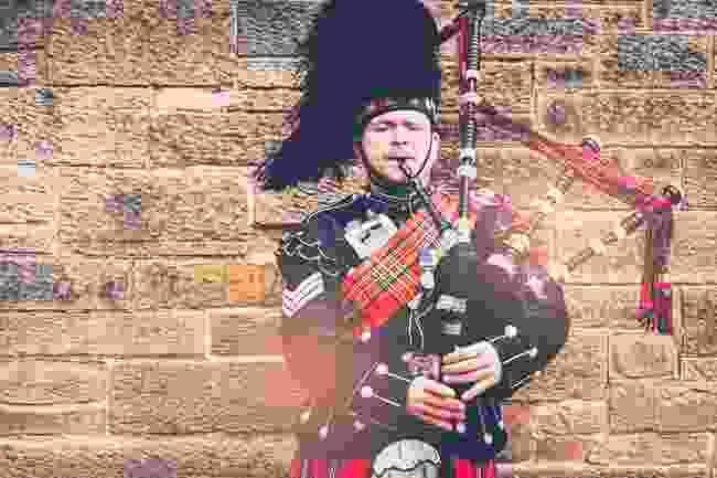 A bagpipe player in Edinburgh (Shutterstock)