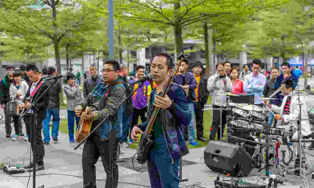 A local street band performing at Shenzhen's central park (Shutterstock)