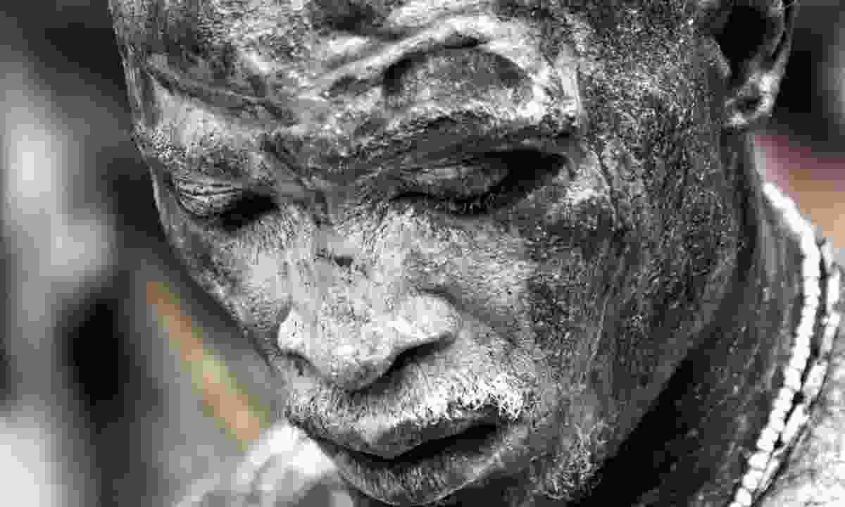 A man in a trance during Ouidah Voodoo Festival, Benin (Shutterstock)