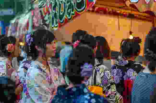 Locals in yukata queuing for festival food in Kyoto, Japan (Shutterstock)