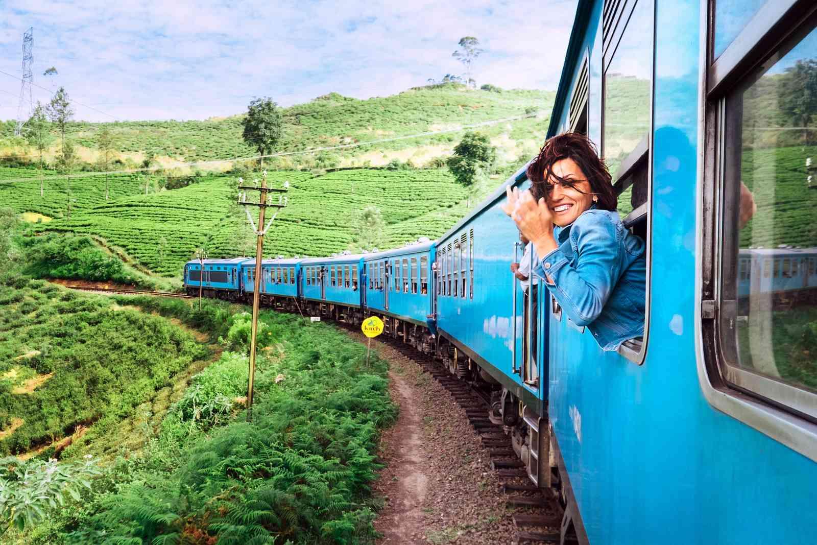 A woman on a train in Sri Lanka (Shutterstock)