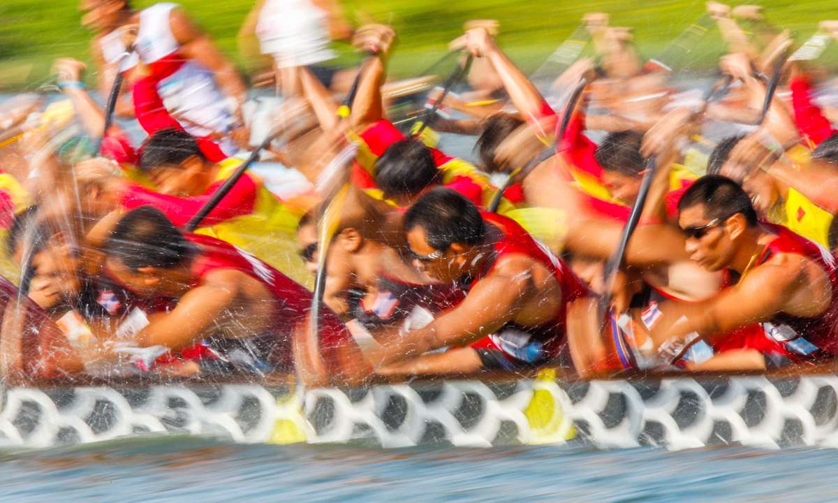 Racing in Macao's International Dragon Boat Race (Macao Government Tourism Office)