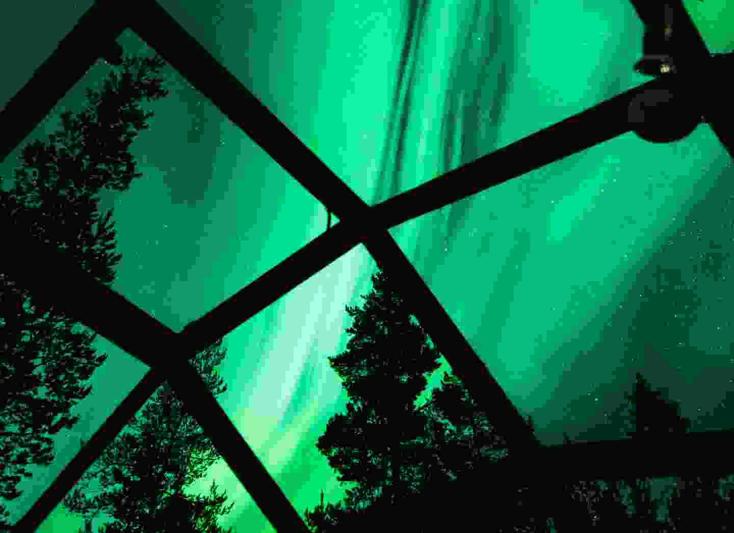 Aurora borealis from inside a glass igloo at Hotel Kakslauttanen, Finland (Dreamstime)
