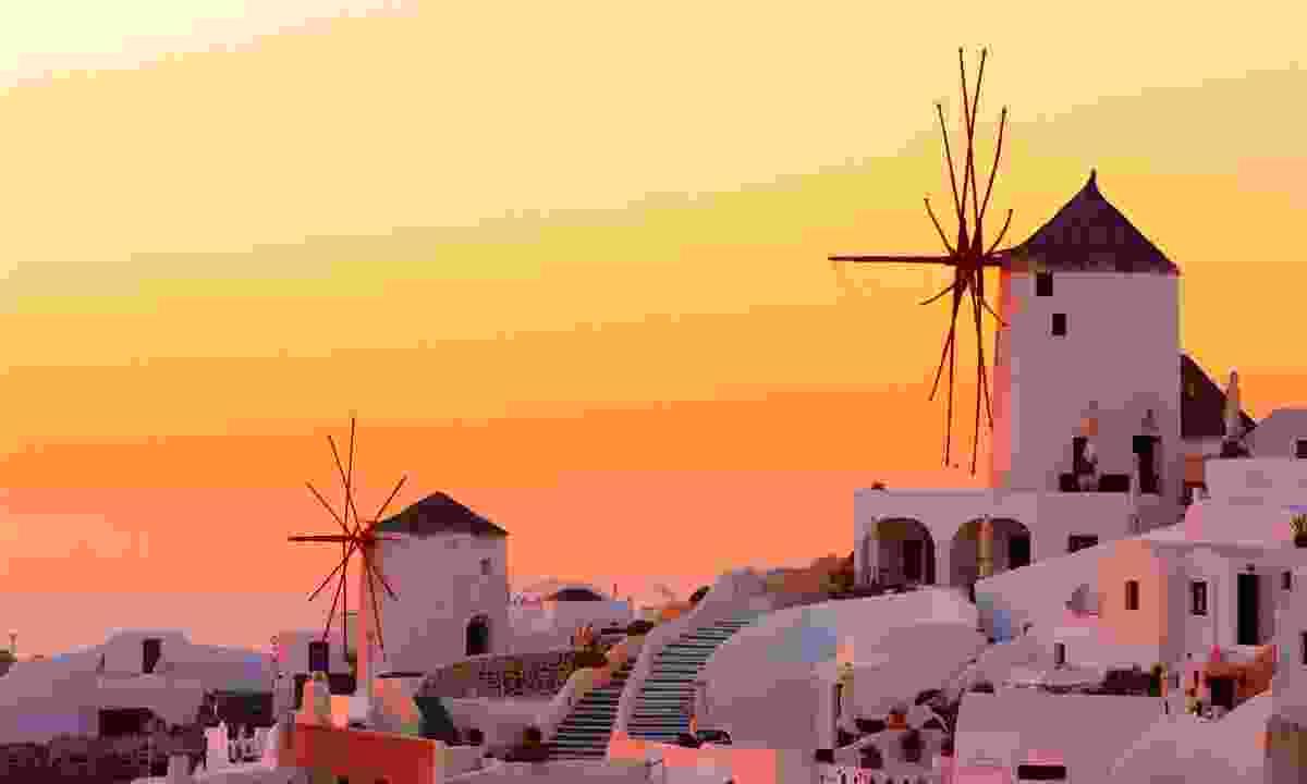 Sunset over Oia village on Santorini island (Dreamstime)